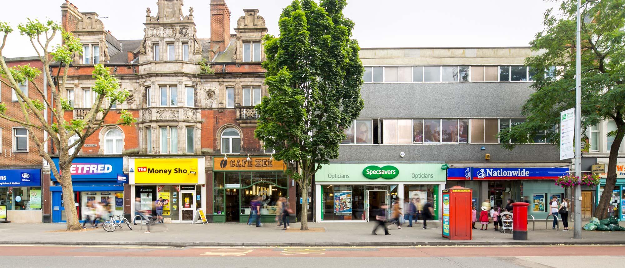 Wide shot of Ealing shops