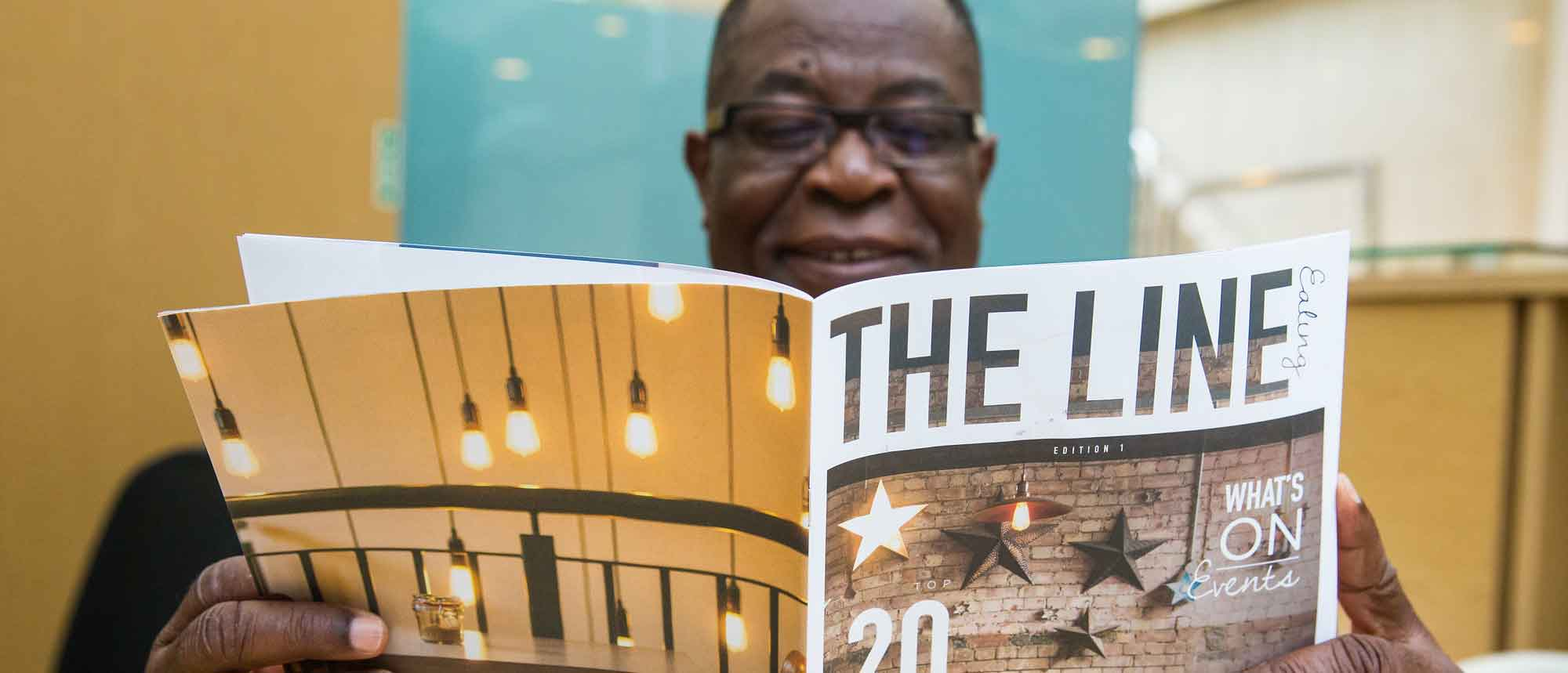 Man reading The Line magazine